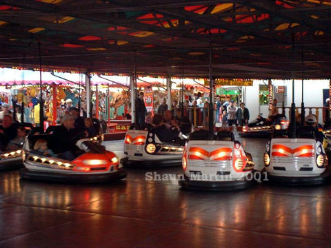 John Collins traditional build up dodgems cars at Knutsford May Day fair,image